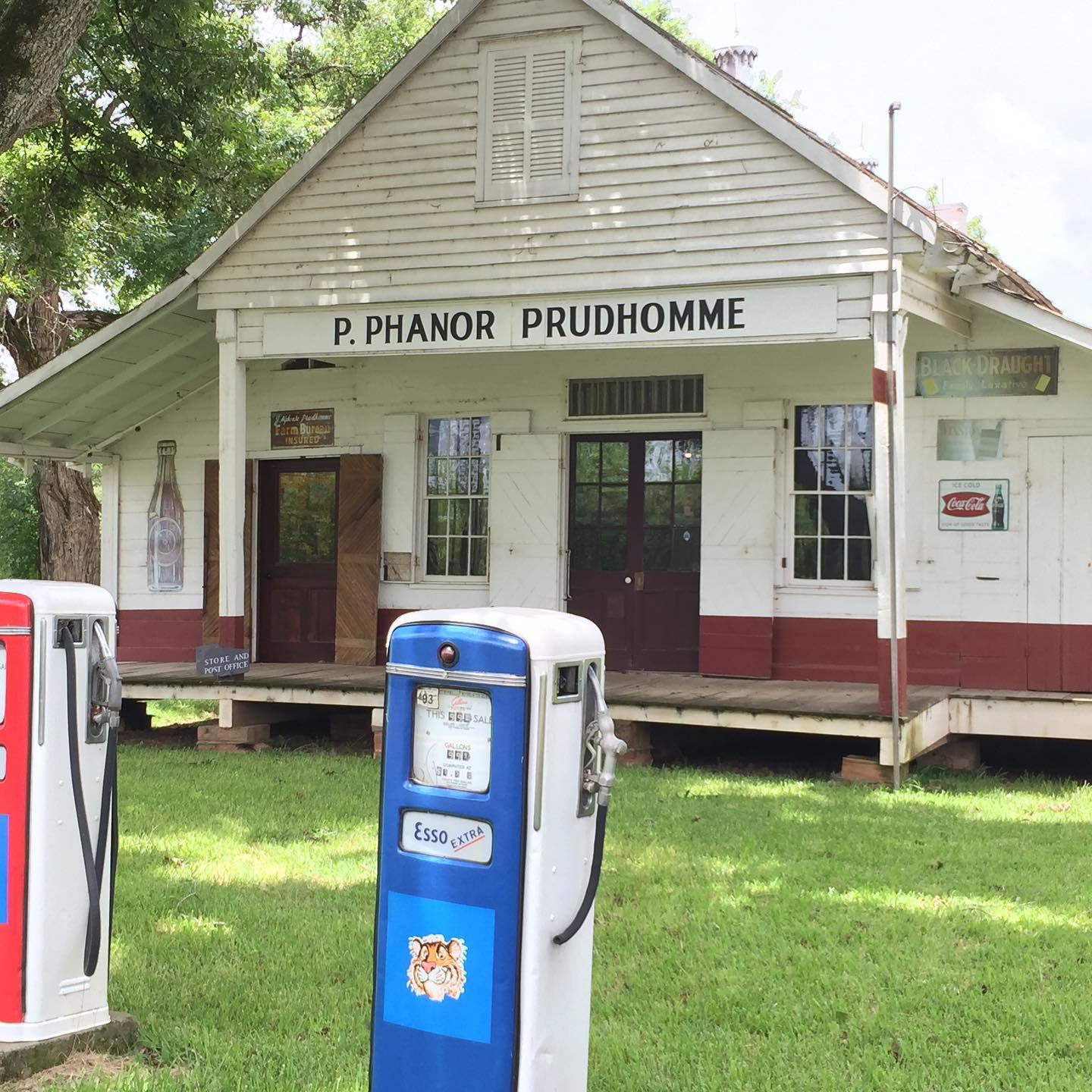 Two gas pumps in front of the Oakland Plantation Store.