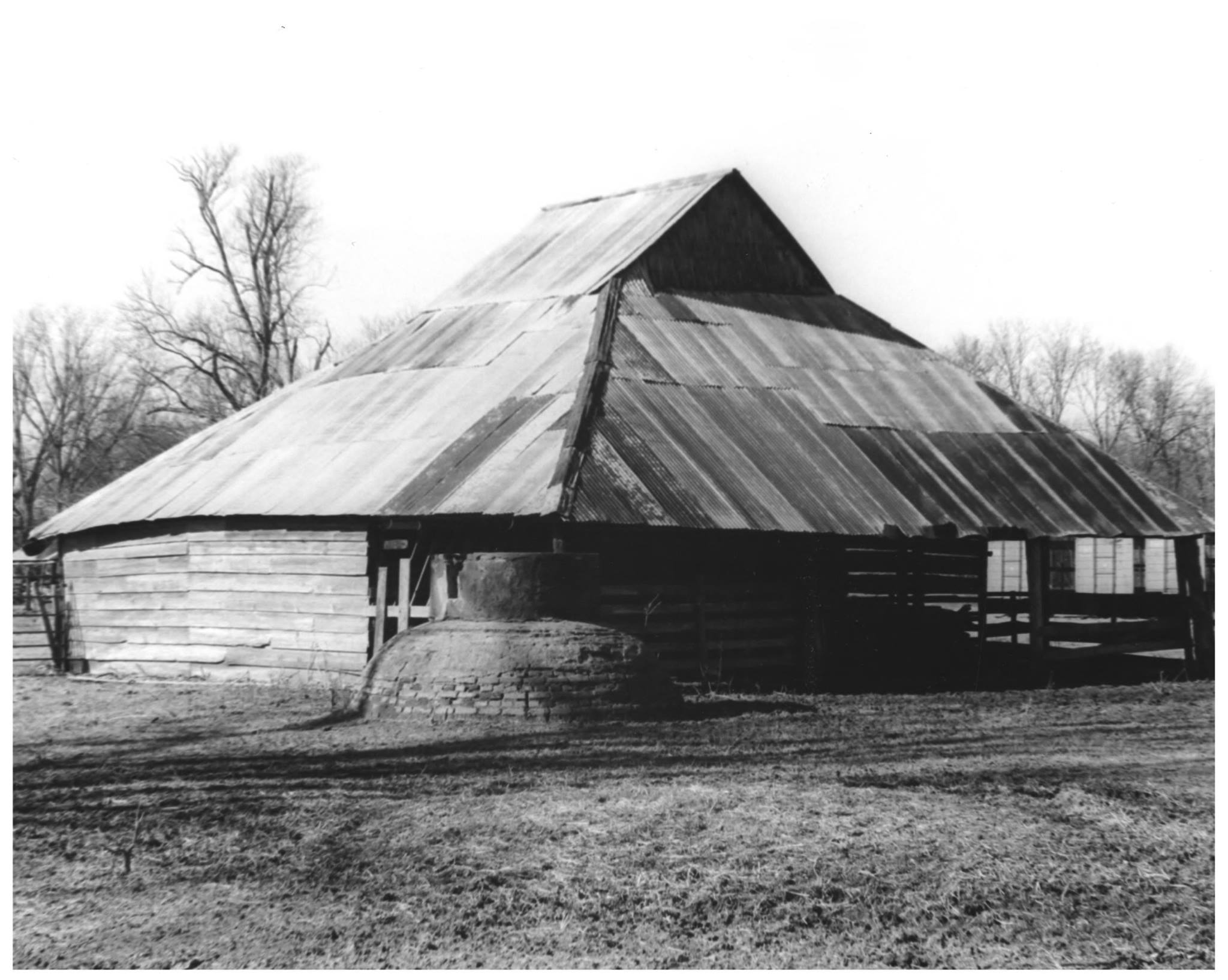 The wooden Oakland Corn Crib has a peaked metal roof.