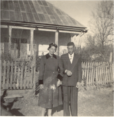 Leo and Camille Metoyer stand in front of a picket fence that surrounded the Oakland Overseer's House.