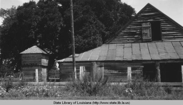 1930s black and white photograph of the Magnolia Blacksmith Shop.